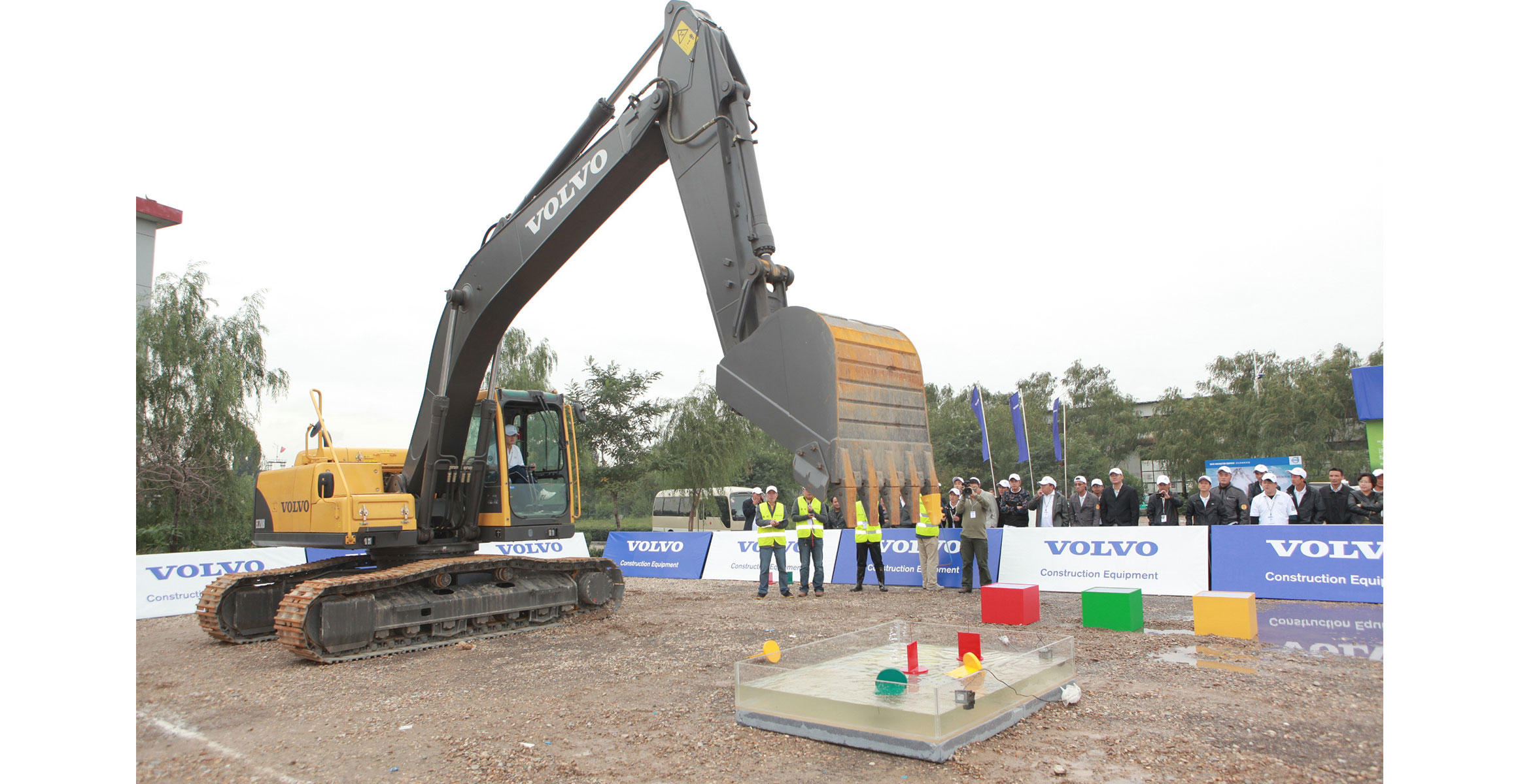 The operator of a Volvo EC210B crawler excavator participates in a test of skill and precision during Operator Idol.