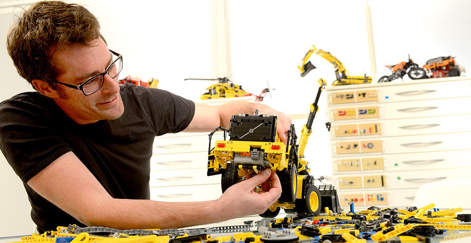 LEGO® Technic design manager, Jeppe Jul Jensen assembles the model Volvo L350F wheel loader.