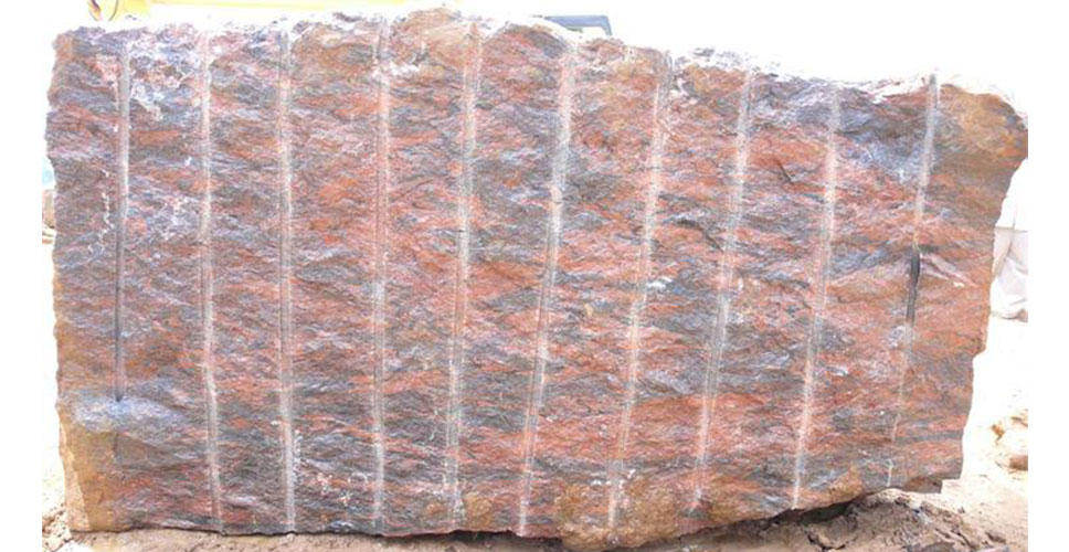 A rough block of rare Ilkal granite