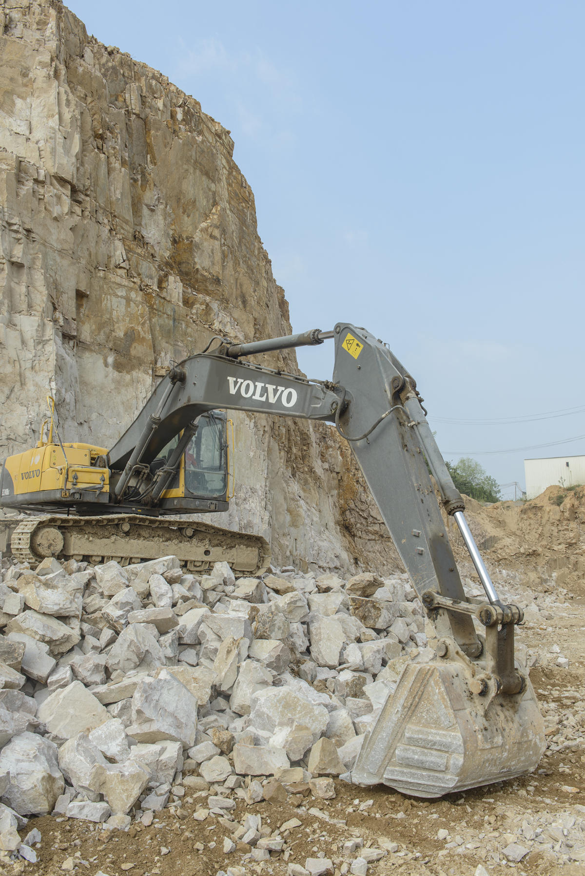 Another Volvo excavator is hard at work on the rocky terrain