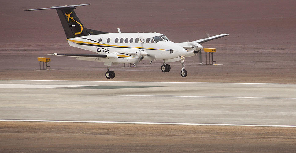 The Beechcrft King Air comes in to land on the runway.