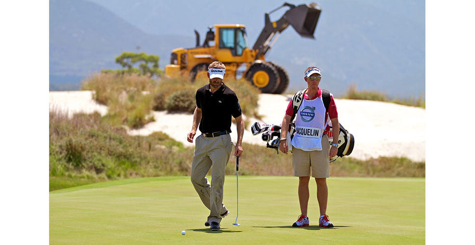 Raphael Jacquelin and caddy at the Volvo Golf Champions event 2012 at the Links, Fancourt, South Africa