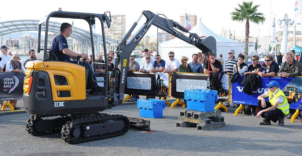 A contestant uses a Volvo EC18C compact excavator to complete a challenge during the Operators Club Final in Alicante.