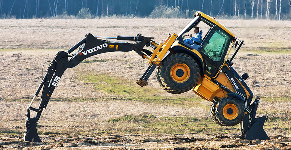 A Volvo BL71B backhoe loader performs an impressive stunt that will be recreated at ConExpo/CTT Russia.