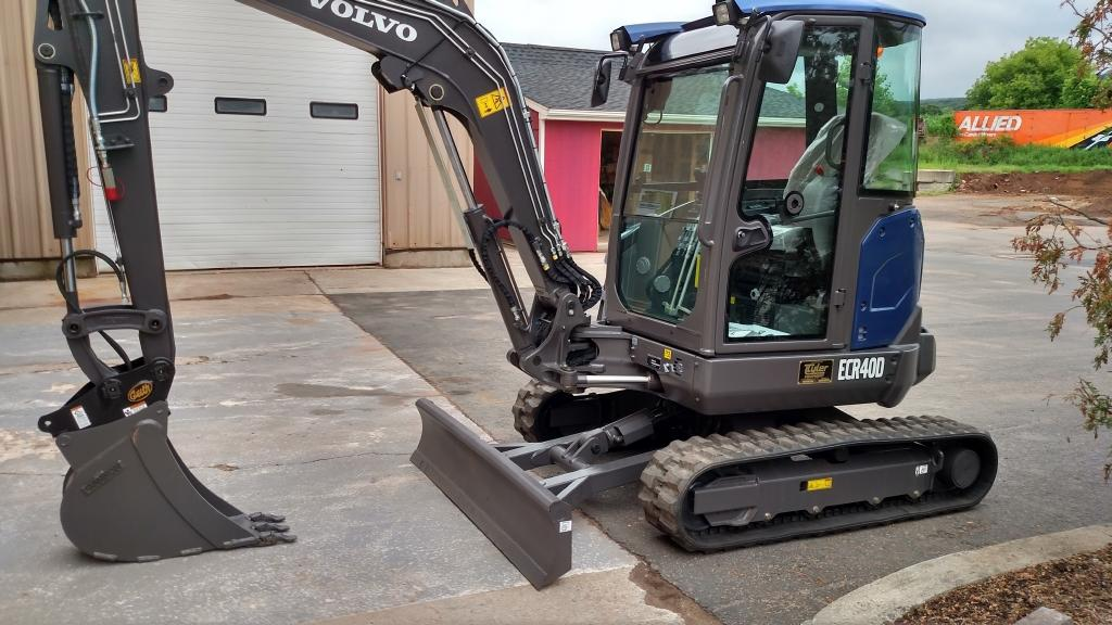 Volvo ECR40D mini excavator painted in Volvo Ocean Race blue for Barber Utilities
