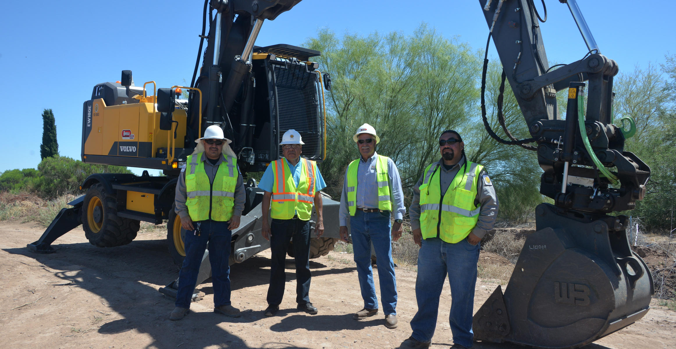Workers at Salt River PIMA-MARICOPA Indian Community using a Volvo EW180E wheeled excavator