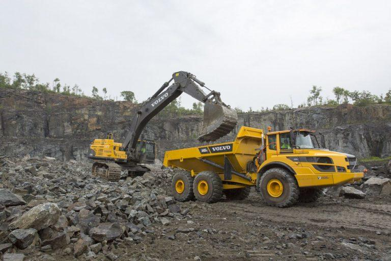 A Volvo excavator loads an A40G articulated truck for Barton