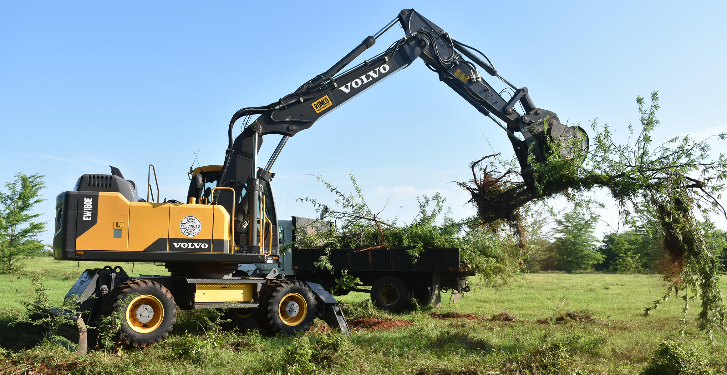 Wheeled excavators used for storm clean-up in Rusk County, Texas