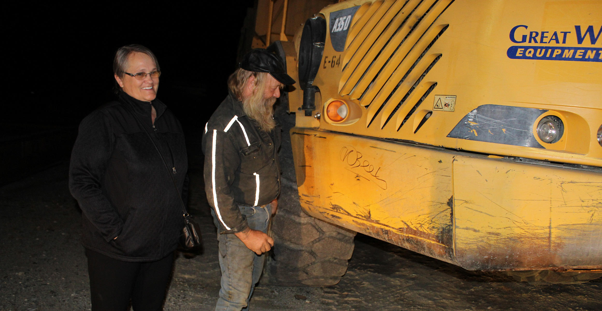 Tony Beets from Gold Rush signs a donated Volvo Articulated Truck