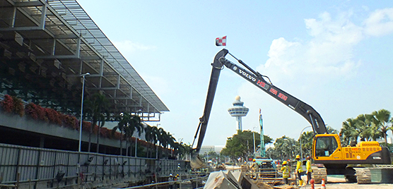 A Volvo excavator is used to maneuver steelwork on the development of the taxi underpass.