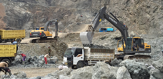 Alam Jaya CV owns three Volvo Construction Equipment vce excavators including two EC210B-Primes and one EC220DL to load the rock onto trucks amid what looks like a lunar landscape