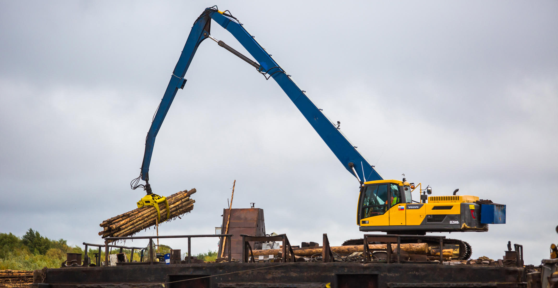 Modified Volvo EC250 excavator with grapple